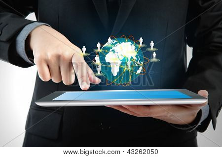 Business man using a touch screen device with social network (Elements of this image furnished by NASA)