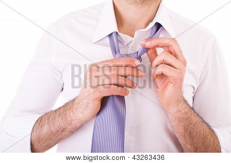 Businessman easing his tie.