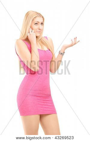 Attractive young woman in a dress using a cell phone isolated on white background