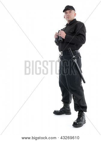 Security man wearing black uniform standing with binoculars, shot on white