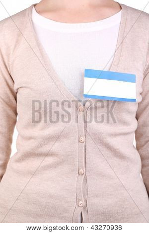 Blank nametag on girl's clothes close up