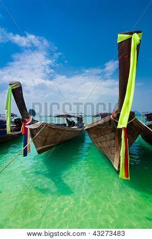 Tropical Beach Landscape. Thai Traditional Long Tail Boats At Ocean Gulf. Thailand