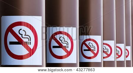Row of No Smoking signs on series of columns