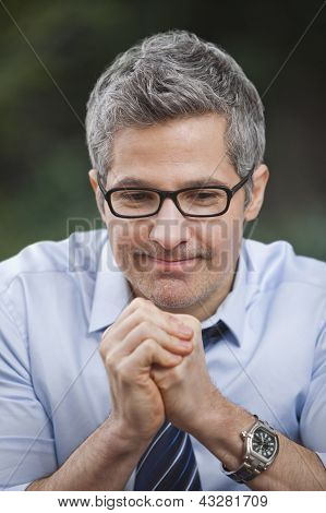 Businessman Thinking With His Hands Clasped