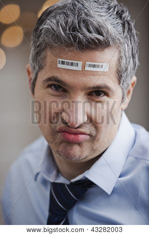 Portrait Of A Businessman With Barcode On Forehead