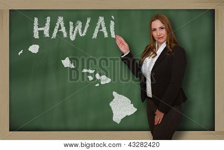 Teacher Showing Map Of Hawai On Blackboard