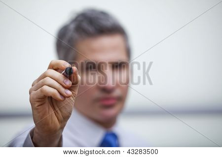 Businessman Pointing With A Felt Tip Pen