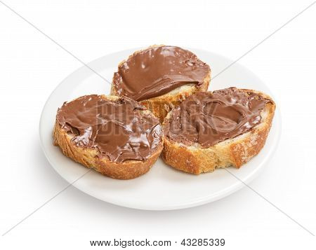 Baguette Slices Spread With Nut-choco Paste On Plate