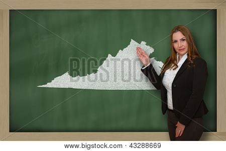 Teacher Showing Map Of Virginia On Blackboard