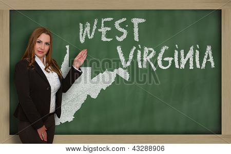 Teacher Showing Map Of West Virginia On Blackboard