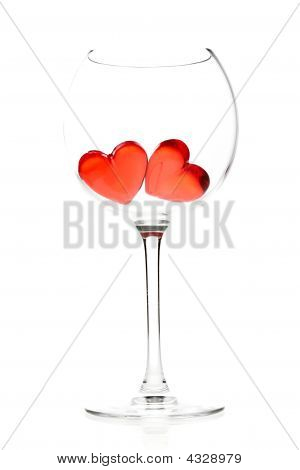 Two Red Jelly Hearts In Wine Glass