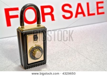 Real Estate Lock Box And For Sale Sign