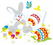 stock photo of upcoming  - Funny rabbit drawing a decorated Easter egg to the upcoming holiday - JPG