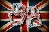 stock photo of british culture  - British theatre and English performing arts concept with an old flag of Britain on a comedy and tragedy mask representing the rich cultural tradition of classical cinema and movie making in England - JPG