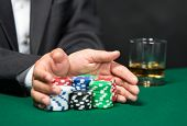 picture of poker hand  - Poker player going  - JPG