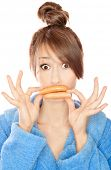 picture of lip augmentation  - Woman with sausages simulating lip enhancement she - JPG