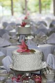 foto of centerpiece  - Small wedding cakes as centerpieces at a wedding reception - JPG