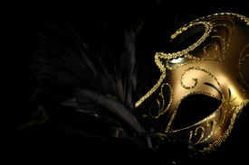 image of masquerade mask  - ornate carnival mask over black silk background - JPG