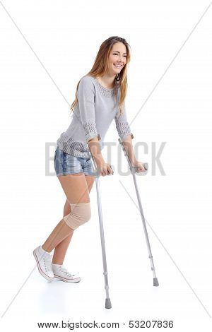 Beautiful Woman Smiling And Hobbling With Crutches