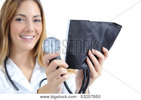 Female Doctor Holding And Showing A Sphygmomanometer