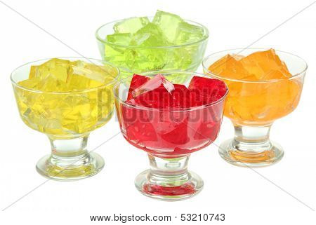 Tasty jelly cubes in bowls isolated on white