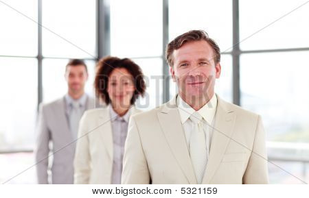 Mature Businessman Leading A Team