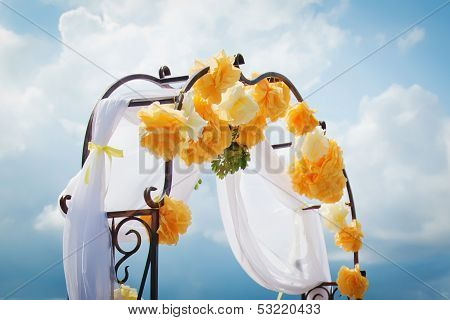 Yellow wedding arch