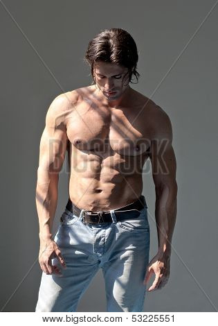 Handsome Muscular Man Shirtless On Grey Background poster