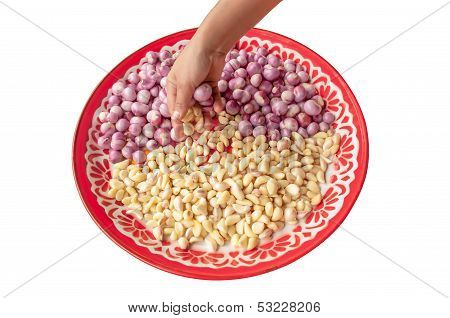 Pick Red Onion And Garlic In Salver.