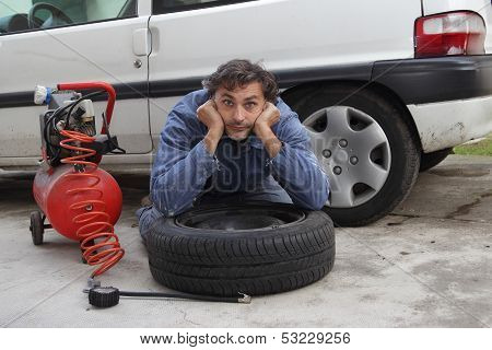 Man And Tire Puncture