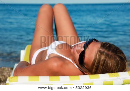Beautiful Woman In Bikini Lying Back