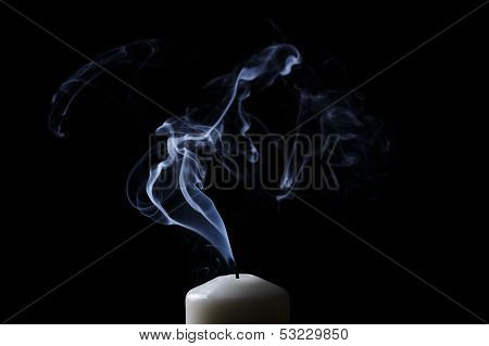 Extinguished Candle With Blue Smoke