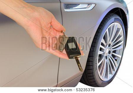 Elegant Woman's Hand Holding Car Keys