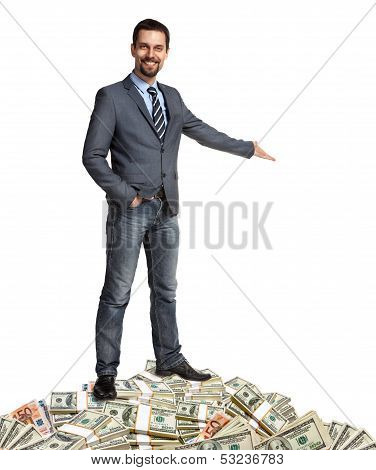 Happy businessman shows the way how to make a lot of money
