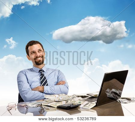 Daydreaming businessman with arms crossed
