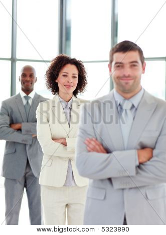 Friendly Young Businesswoman With Folded Arms