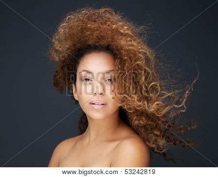 Portrait Of A Beautiful Young Woman With Hair Blowing