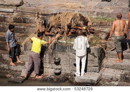 Kathmandu, Nepal - September 21: Cremation Ceremony Along The Holy Bagmati River
