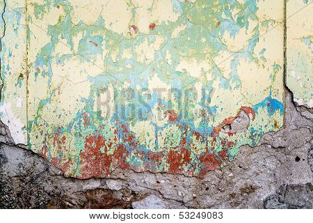 Textured Wall That Is Crumbling With Red Stains