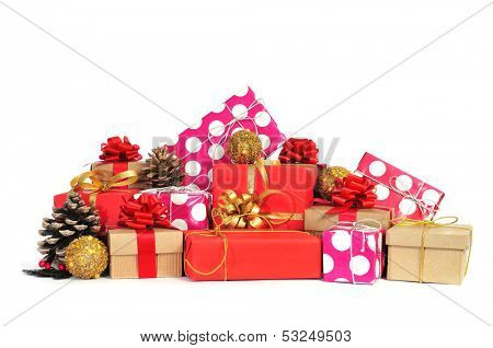 some christmas gifts wrapped with wrapping paper of different colors and ribbon bows, and some christmas ornaments on a white background