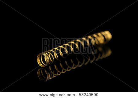 Coil spring on black background