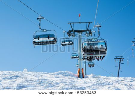 Cableway with skiers at the ski resort