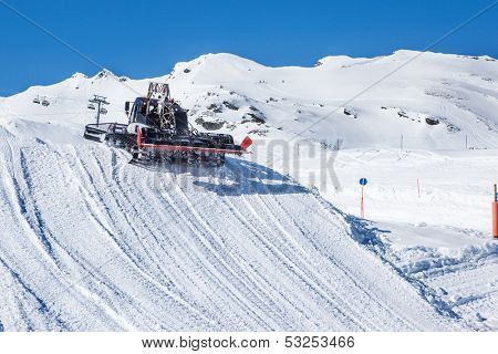 Snowcat preparing a slope at skiing resort