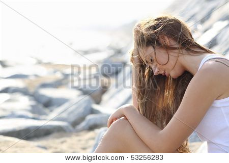 Worried Woman On The Beach