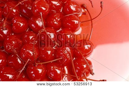 Festive Background Of Red Cocktail Maraschino Cherries With Stems - With Copy Spacee For Your Text H