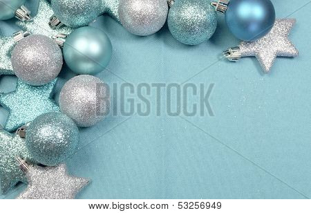 Festive Background Of Aqua Torquiose Pale Blue Christmas Glitter Baubles And Stars On A Pale Aqua Bl