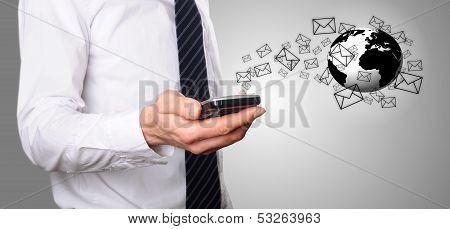 Businessmann Look At Emails On His Mobile Phone