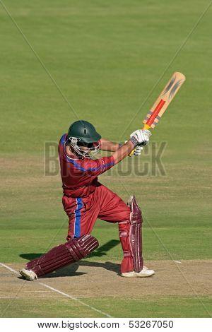 A cricket batsman in action