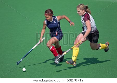 BLOEMFONTEIN, SOUTH AFRICA - AUGUST 7: Unidentified players during a women's field hockey match between the North West and Free State Universities, on Aug 7., 2010 in Bloemfontein, South Africa.