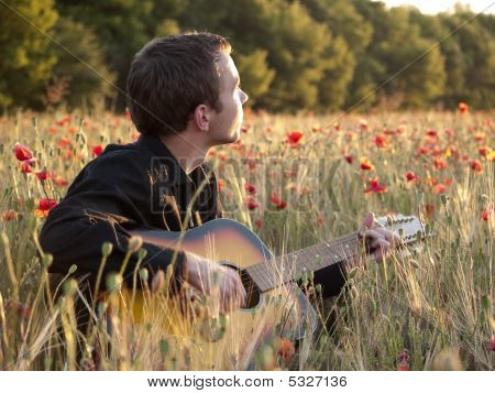 Guitarist In Field